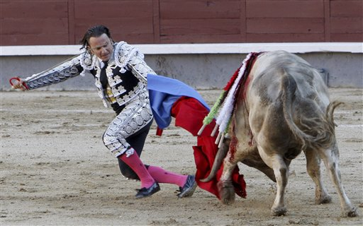 In this photo made Friday, May 21, 2010, Spanish matador Julio Aparicio is seen minutes before being gored by a bull during a bullfight during the San Isidro Feria at the Las Ventas bullring in Madrid. Aparicio underwent surgery and is out of critical danger. (AP Photo/Domingo Botan)